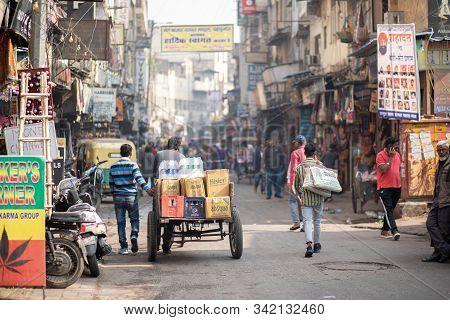 Delhi, India - December 04, 2019: People On Busy Street At Main Bazaar In Paharganj District.