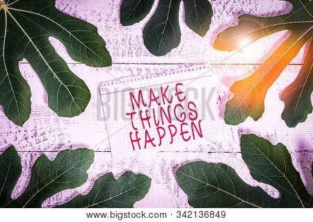 Word writing text Make Things Happen. Business concept for Exert Effort to Achieve and Fulfill something Go and Act Leaves surrounding notepaper above a classic wooden table as the background. poster