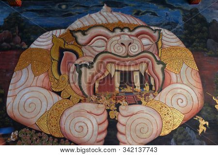 Bangkok, Thailand, December 27, 2018. Vintage Wall Drawing Depicting A Monster Devouring People. Ram