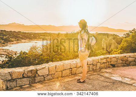 Girl Looking At Capo Ferro In Costa Smeralda Sardinia Italy