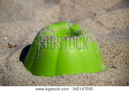 Green Sand Mould As A Cake Mould Like A Ball Cake Lies In The Granular Sand And Is Sprinkled With Sa
