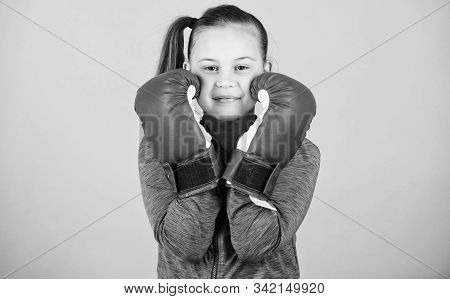 Contrary To Stereotype. Boxer Child In Boxing Gloves. Female Boxer. Sport Upbringing. Boxing Provide
