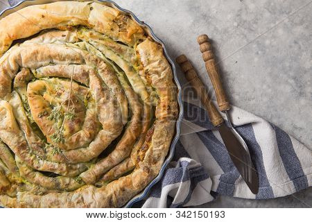 Spanakopita. Greek Pie Spanakopita  Over Concrete  Background. Ideas And Recipes For Vegetarian Or V