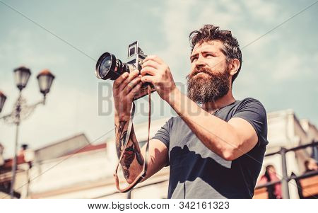 Man With Long Beard Shooting Photos. Manual Settings. Photographer Hold Vintage Camera. Modern Blogg