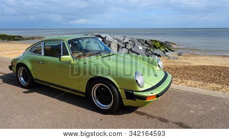 Felixstowe, Suffolk, England - May 05, 2019: Classic Green Porsche Motor Car Parked On Seafront Prom