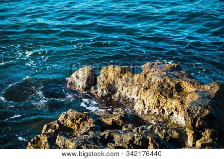 Ocean Waves Wash The Stones. Rocky Shore. Sea Foam. Beautiful Sea Coast. Pure Water. Water Surface.