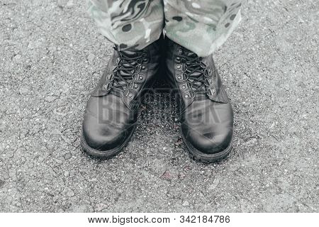Soldier's Boots Close-up. Army. Tinting, Black, Serviceman