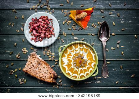 Autumn Pumpkin Soup With Cream Served With Lard