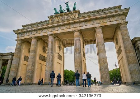Berlin, Germany - April 28, 2019: Tourists In Front Of The Brandenburg Gate In Downtown Berlin