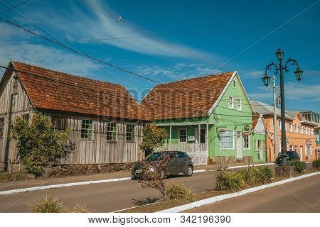 Cambara Do Sul, Brazil - July 19, 2019. Flamboyant Light Pole And Old Houses On The Calm Getulio Var