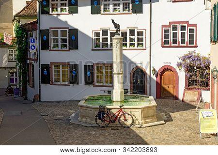 Basel, Switzerland - April 17, 2019. Old Town. Gems-brunnen Fountain On The Gemsberg Street Surround