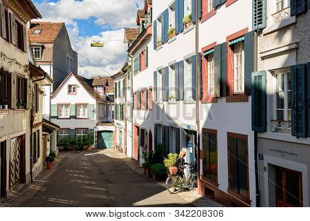 Basel, Switzerland - April 17, 2019. Picturesque Historical Neighborhood In The Spring. Woman On A B