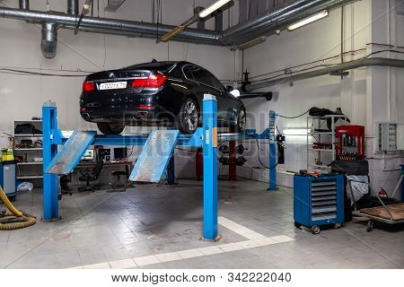 Novosibirsk, Russia - 08.01.2018: Used Car Bmw Stands On The Stand Wheel Alignment Convergence Of Th