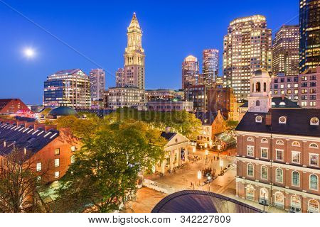 Boston, Massachusetts, USA skyline with Faneuil Hall and Quincy Market at dusk.