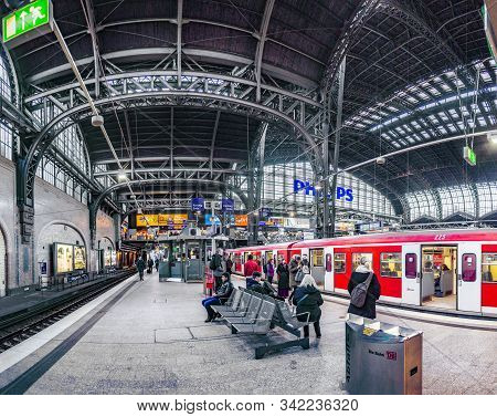 Hamburg, Germany - February 3, 2016: People In The Morning Wait For The Train In The Central Station