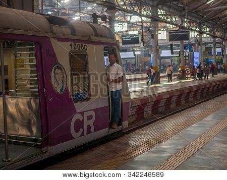 Motorman Standing On Train Door