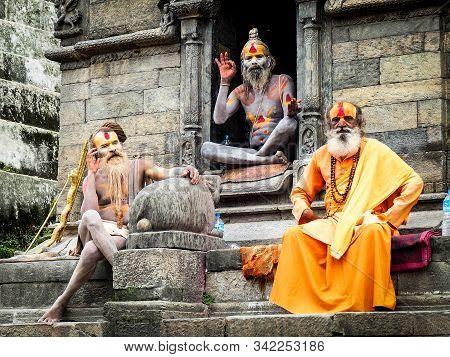Varanasi,india,october 2019,three Sadhus Sitting In The Temple.
