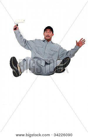 Shocked painter falling backwards