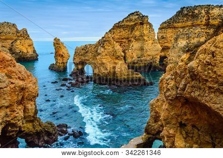 Ponta Da Piedade Cliffs Near Lagos, Portugal. Beautiful Seascape With Natural Rock Formations In The