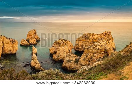 Ponta Da Piedade Cliffs At Sunset Near Lagos, Portugal. Beautiful Seascape With Natural Rock Formati