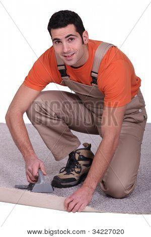 Man placing carpet