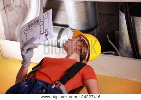 Women with a sketch of industrial facility
