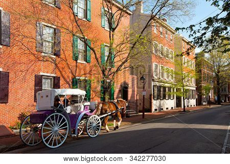 Philadelphia, Pennsylvania, United States - April 23, 2011: Tourist In A Horse Drawn Cart On A Stree