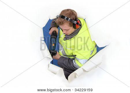 Man drilling through background