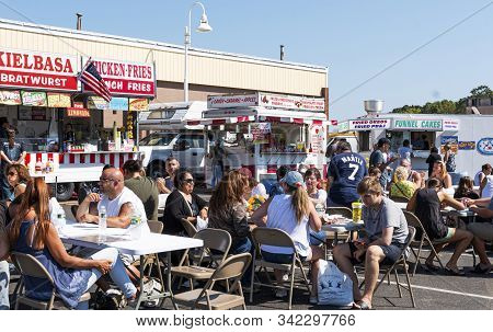 West Islip, New York, Usa - 22 September 2019: People Sitting At Tables Enjoying The Food At A Local