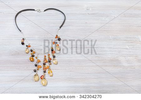 Needlecraft Background - Top View Of Hand Crafted Necklace Decorated By Chains With Natural Citrine