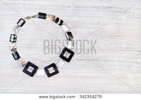 Needlecraft Background - Top View Of Hand Crafted Necklace From Horn Frames, Silver Balls, Square St