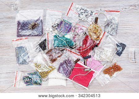 Needlecraft Background - Top View Of Various Items, Beads, Bugles, Spangles, Threads, Gimps For Embr