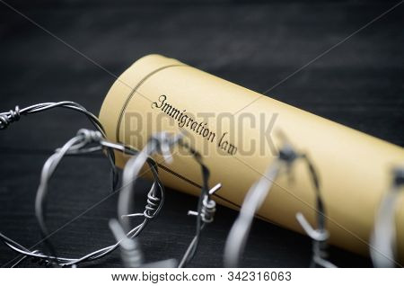 Immigration Law And Barbed Wire On Wooden Background, Immigration Concept
