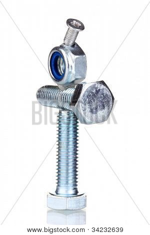 Stack of balanced screws isolated on white