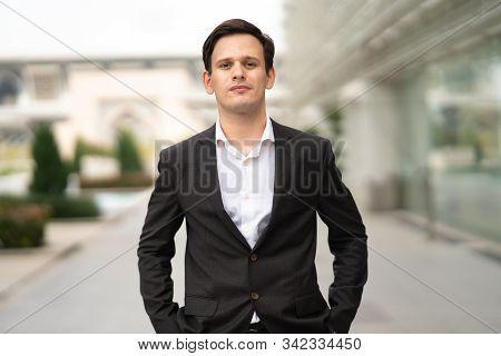 View of businessman portrait with blur background