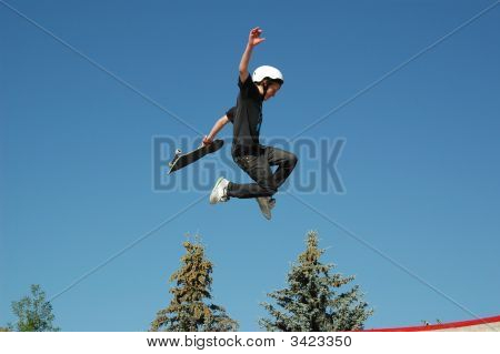 Young Teen At The Local Skate Park