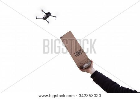 An Autonomous Mail Delivery Drone With A Hand Holding Up A Package To The Sky.
