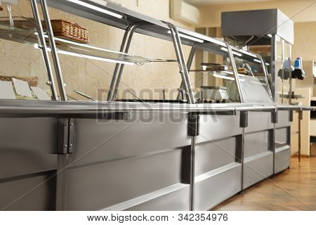 Serving Line With Food In School Canteen