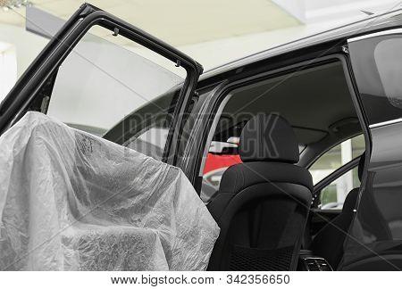 Modern Car With Wet Tinted Window, Closeup