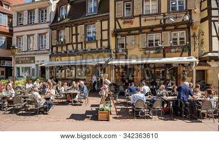 Colmar, France - April 18, 2019. Overcrowded Restaurant In The Old Half-timbered House, Decorated Wi
