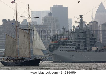 HOBOKEN, NJ - MAY 23: The RFA Argus A135 (UK) passes a tall ship on the Hudson River near Manhattan during the Parade of Sails on May 23, 2012 in Hoboken, NJ. The parade marks the start of Fleet Week.