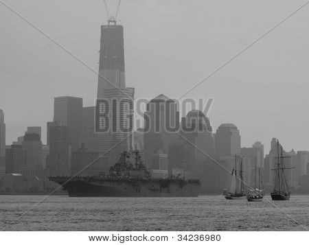 HOBOKEN, NJ - MAY 23: The USS Wasp (LHD 1) on the Hudson River with Manhattan in the background during the Parade of Sails on May 23, 2012 in Hoboken, NJ. The parade marks the start of Fleet Week.