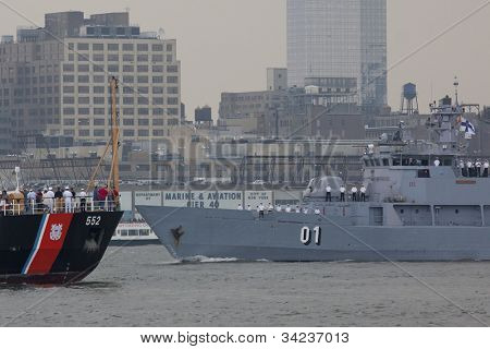 HOBOKEN, NJ - MAY 23: FNS Pohjanmaa (Finland) and USCGC Willow (WLB 202) pass on the Hudson River during the Parade of Sails on May 23, 2012 in Hoboken, NJ. The parade marks the start of Fleet Week.