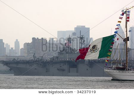 HOBOKEN, NJ - MAY 23: Buque Escuela Arm Cuauhtemoc (Mexico) sails past the USS Wasp (LHD 1) during the Parade of Sails on May 23, 2012 in Hoboken, NJ. The parade marks the start of Fleet Week.