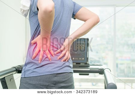 Back Pain, Close Up Young Man Has Muscle Injury During Run On Treadmill, Sport Exercising Injury