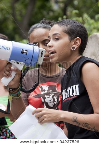NEW YORK - JUNE 22: A member of Fierce, a group of primarily LGBTQ youth of color, speaks to supporters in Washington Square Park on the 8th Annual Trans Day of Action on June 22, 2012 in New York.