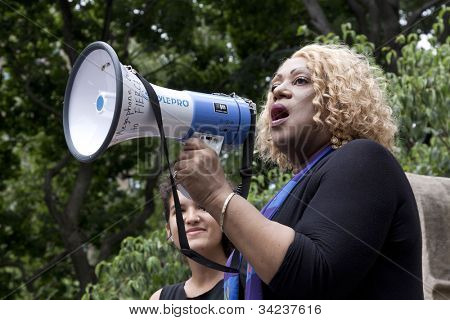 NEW YORK - JUNE 22: The Reverend Moshay Moses speaks to an audience of supporters in Washington Square Park during the 8th Annual Trans Day of Action on June 22, 2012 in New York City.