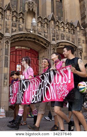 NEW YORK - JUNE 22: Supporters march past a church in Lower Manhattan during the 8th Annual Trans Day of Action on June 22, 2012 in New York City.