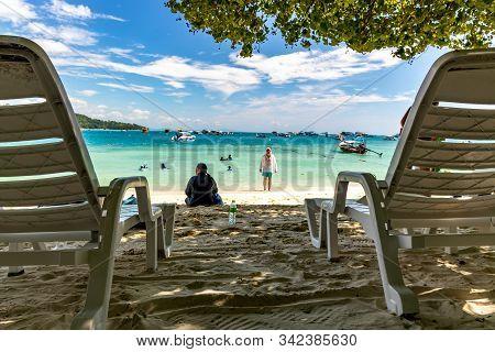 Koh Phi Phi - November 26 2019: Beach Chairs At Loh Dalum Beach In Phi Phi Island, Thailand.