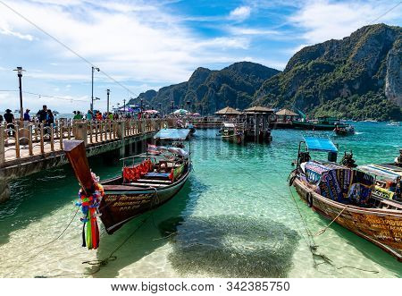 Phi Phi, Thailand - November 26 2019: Traditional Wooden Longtail Boats Parked At Phi Phi Island Pie